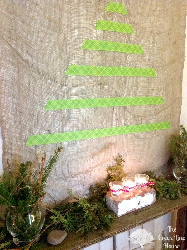 Christmas fantel (fake mantel) decor with lots of real greenery