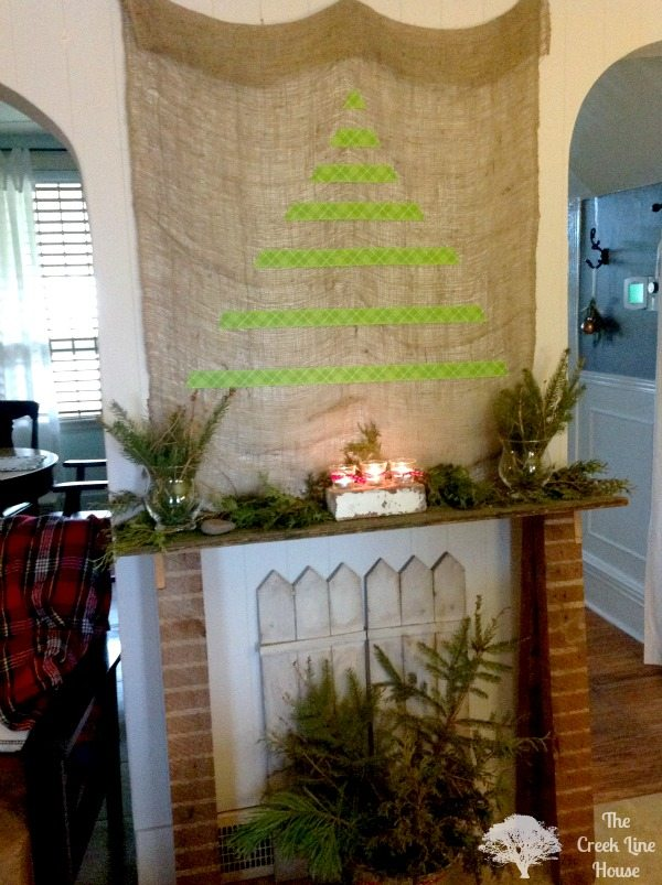 Christmas fantel (fake mantel) with lots of real greenery