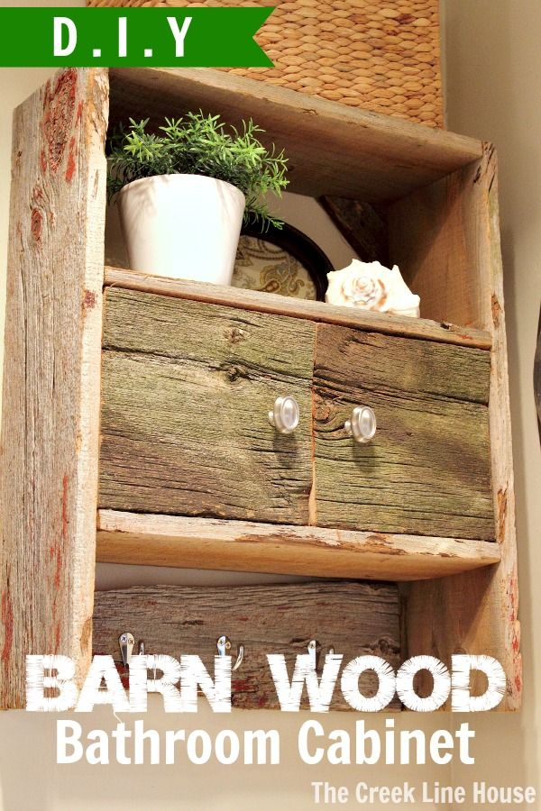 DIY Barnwood Bathroom Cabinet made by taking an old cabinet apart and rebuilding it using barnwood instead!