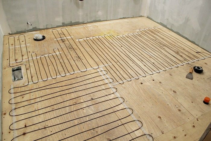 How to install a heated tile floor and also how not to for Concrete floor upstairs