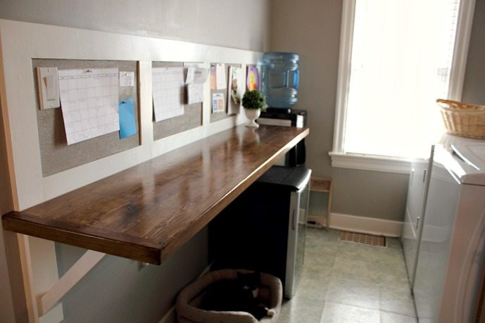 DIY faux butcher block counter that you can make for super cheap! This shows you how to make really cute brackets for it too if you don't have a cabinet underneath and how to turn the whole thing into a command center with a cork board too!