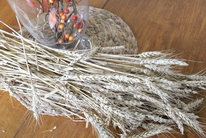Quickly and easily make a wheat sheaf for your fall decor or harvest table centerpiece with this simple step-by-step guide.