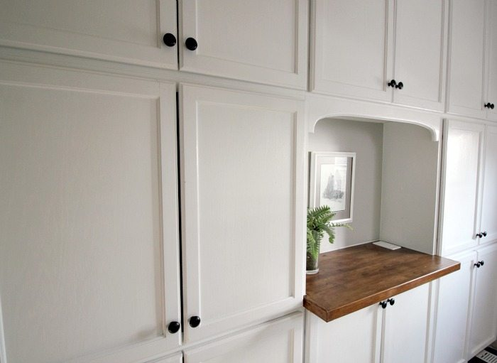 This wall of built-in cabinetry was surprisingly easy and affordable to install and makes a huge difference to everyday life with everything it can keep organized!