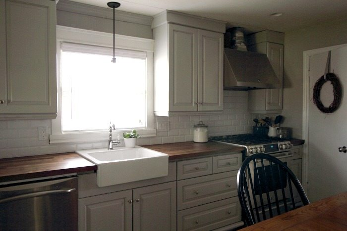 Perfect It us easy to update the look of your old kitchen cabinets with some simple mouldings and