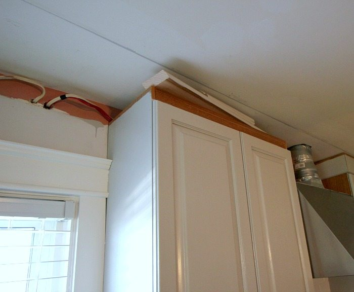 Luxury It us easy to update the look of your old kitchen cabinets with some simple mouldings and