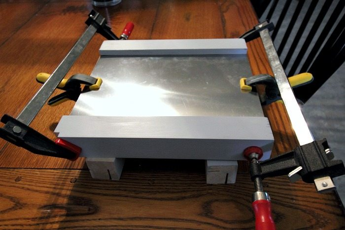 How to DIY a range hood vent pipe cover. Something like this is especially useful in an old house with wonky walls and ceilings!