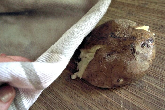 Learn how easy it is to come home to perfect baked potatoes when you make baked potatoes in a crock pot!