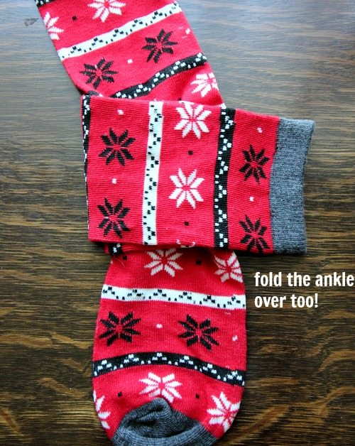 "Then fold over the top part (the ankle part) of the same ""under"" sock right over top."