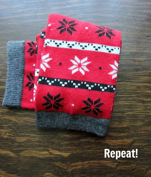 Now follow the same process of folding the toe part up and over, tucking it in, and then folding the top, or ankle, part of the sock over.