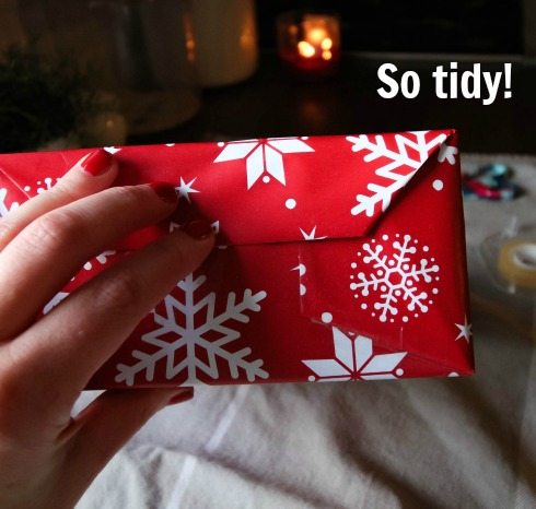 How to wrap Christmas presents with crisp corners and smooth edges. Finished!