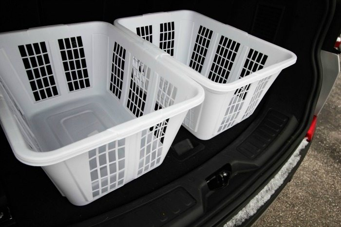 The most challenging part of any shopping trip is organizing all those bags in your truck.  The only thing tougher is hauling all those bags inside when you get home.  Our simple, inexpensive trunk organizing trick will solve both of those problems in one fell swoop.