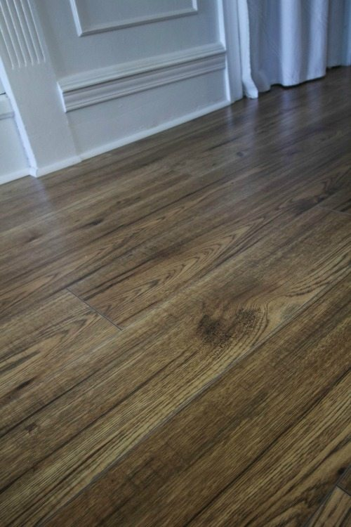 We chose laminate flooring for the main rooms in our home instead of hardwood and we haven't regretted it for a second!