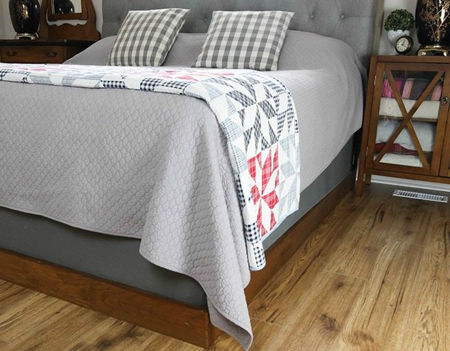 Make your own simple bed frame for your giant bed instead of paying thousands for one from the store!