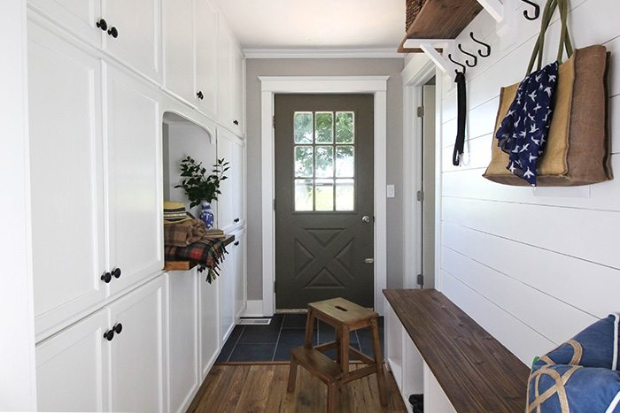 This tiny DIY mudroom is just filled with storage from top to bottom!