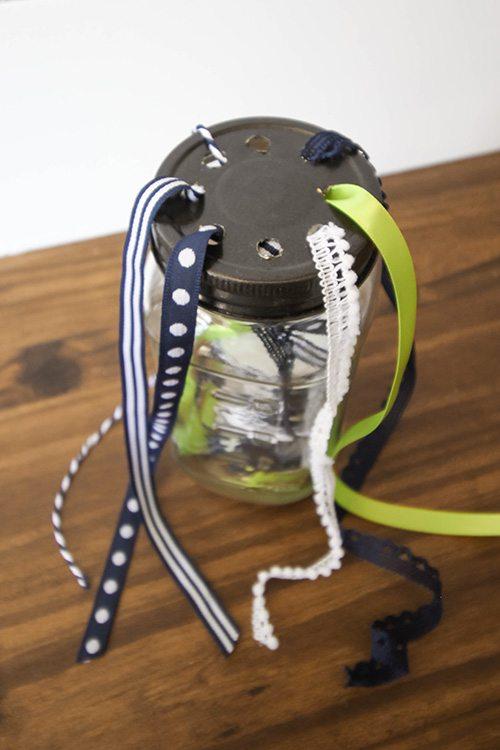 Organize your ribbons with this DIY mason jar ribbon organizer!