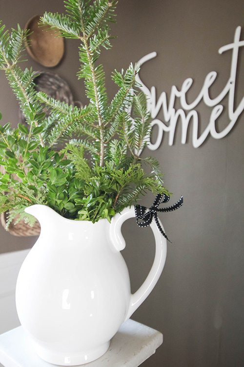 A rustic Christmas home tour with simple farmhouse-style decor ideas that you can copy in your home this Christmas!
