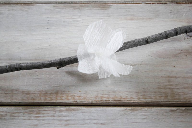 Can you believe these spring blossom branches are made out of paper?! This is such an easy and affordable way to bring a little hint of spring to your home!