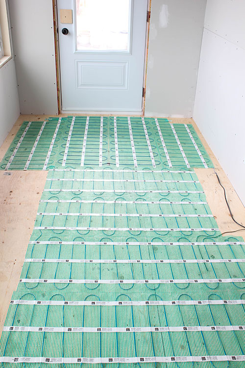 If you dream of having heated floors in your home but worry about what a big, difficult project installing them can be, check out this easy to install heated flooring system! This is definitely the way to go!