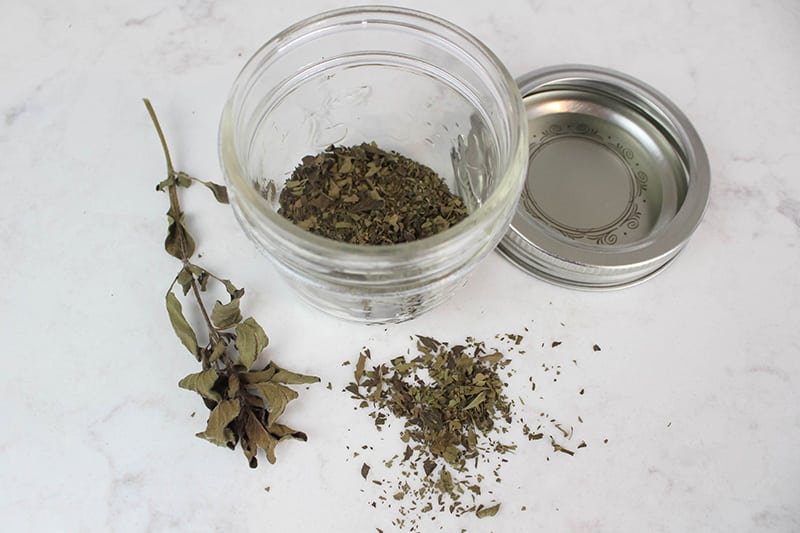 I love to dry herbs in the oven if I'm feeling impatient and want my herbs to dry right away. This process is of course a little bit more efficient than air-drying them, but if you live in a very humid climate, you may find that you like the results a little better this way as well.