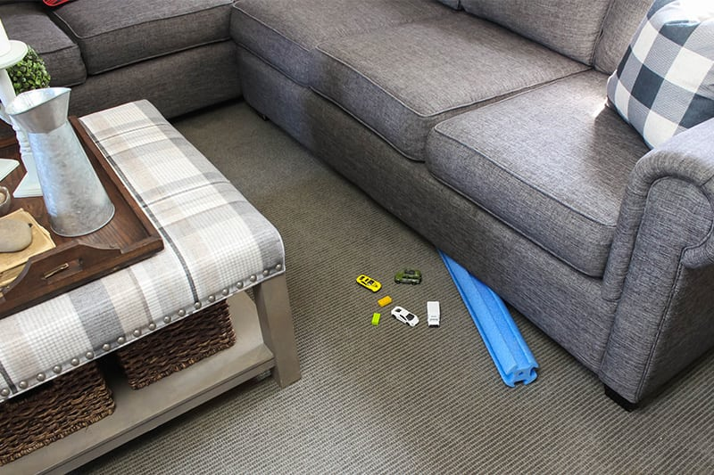 If you're constantly losing things under your couch, then this pool noodle under the couch trick is for you!