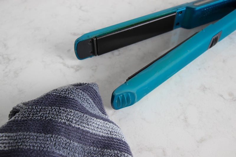 Follow these simple steps for how to clean a flat iron to get your hair straightener sparkly clean in just a few minutes. This is definitely an often overlooked task, but well worth your time!