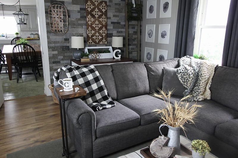 This sofa arm table is a great solution for small spaces and using plumbing pipe to make it gives it a fun industrial look! Here's how you can make a table just like this!