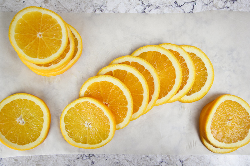 In this post, learn how to dry orange slices to use in traditional Christmas decor as well as in holiday recipes. No fancy equipment required!