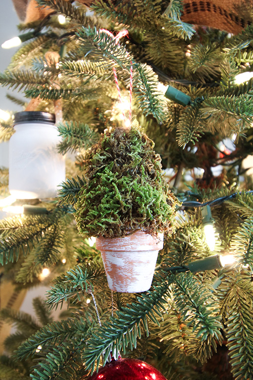 Make these mini topiary Christmas ornaments this year for a fun and unique way to incorporate farmhouse style into your Christmas tree! A great gift idea for the gardener in your life as well!  Finished product.