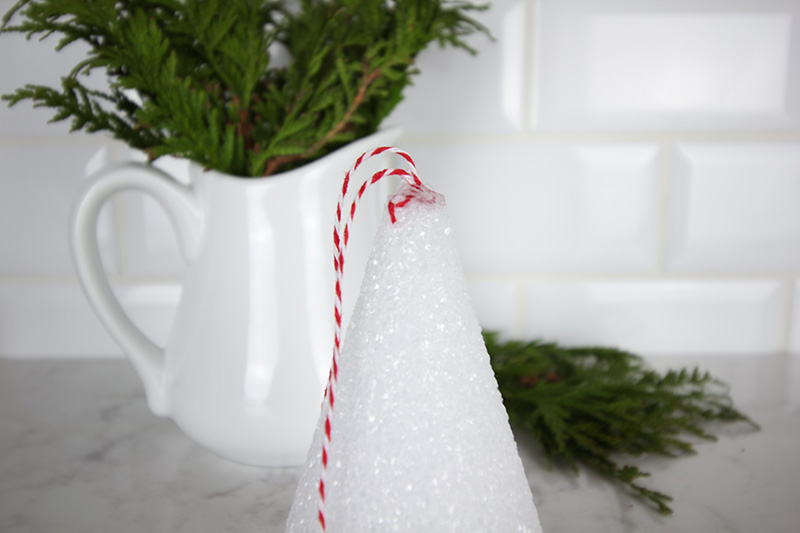 Make these mini topiary Christmas ornaments this year for a fun and unique way to incorporate farmhouse style into your Christmas tree!  Step 3 - attach the string
