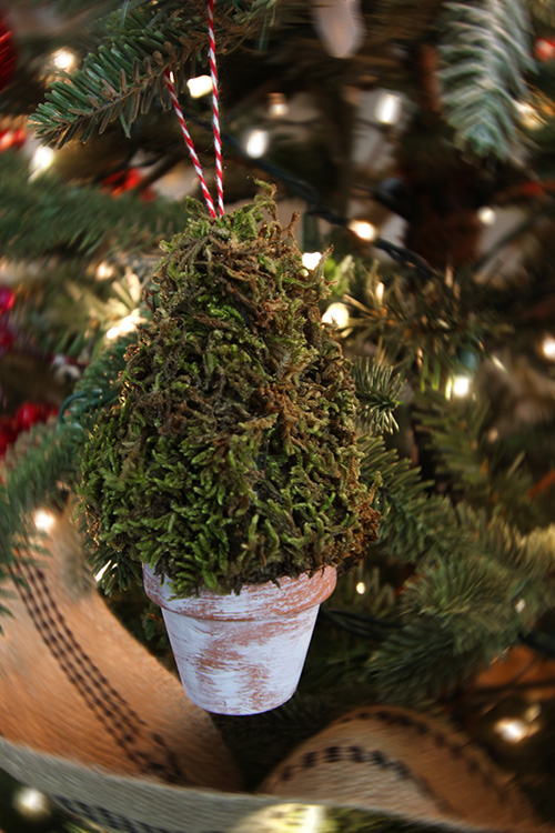 Make these mini topiary Christmas ornaments this year for a fun and unique way to incorporate farmhouse style into your Christmas tree! A great gift idea for the gardener in your life as well! Finished project.