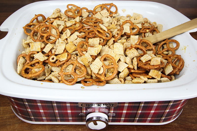This slow cooker Chex mix only takes a few minutes to prepare and will ensure that you always have something to put out for everyone to snack on, no matter who pops by during the Holidays!