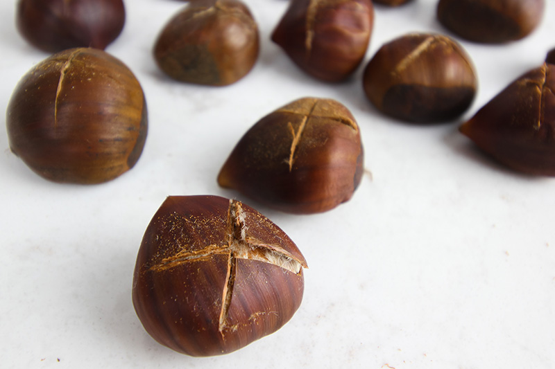 The first very important step is to slice through the outer shell of each chestnut.