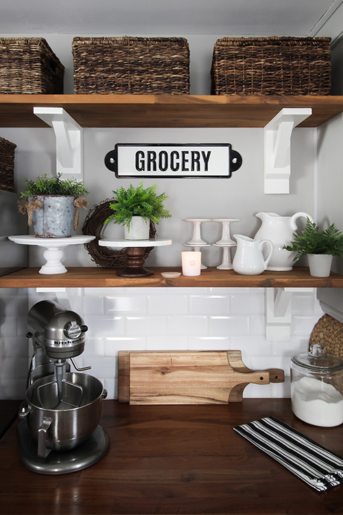 There are a few things you should know before you install open shelving in your kitchen like we have in ours. Read on to learn more about our experience, our tips for making it more functional, and some ideas for making it look great in your home.