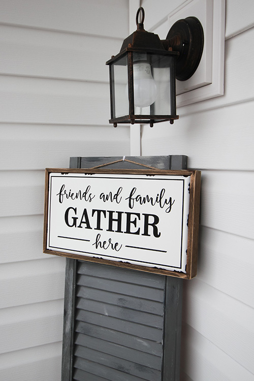 This oversized shutter farmhouse decor idea is a great way to fill a boring blank wall in your home, on your porch, or even in your garden!