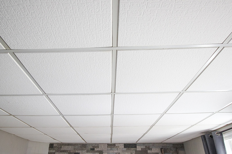 Suspended ceilings can be really practical, but they can seem like eyesores in certain rooms of your home. Here's how to update a suspended ceiling and turn it into a beautiful feature in any room!