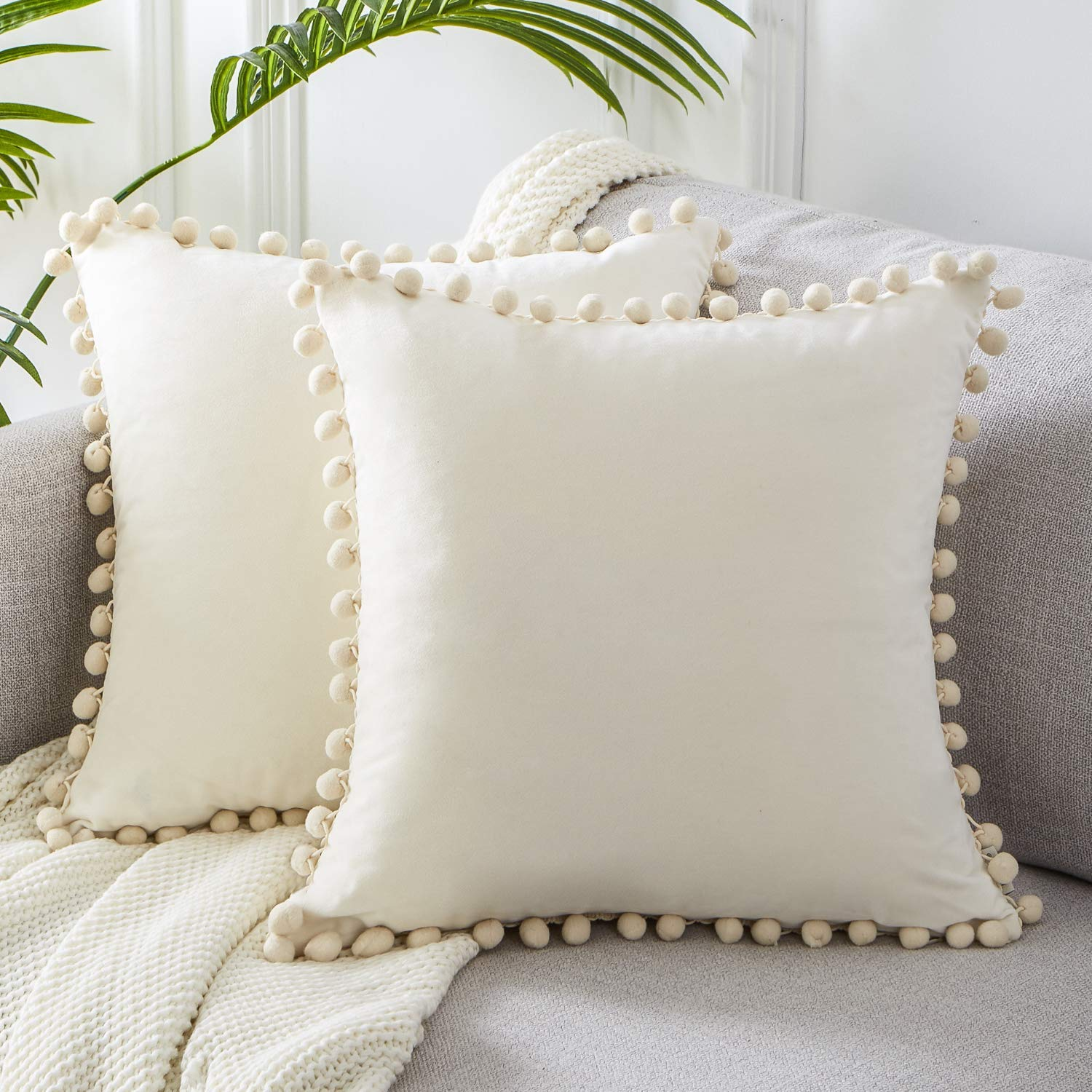 Pom pom tassel pillow covers from Amazon.