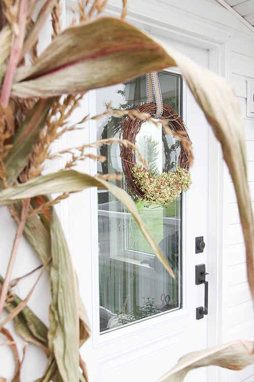 In today's post I'll be sharing my neutral farmhouse fall porch decor for this year that I've put together on the side porch!