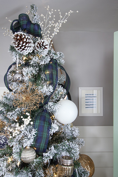 In this post I'm going to add to your Christmas decorating bag of tricks by showing you how to add vertical ribbon to a Christmas tree for a unique look!