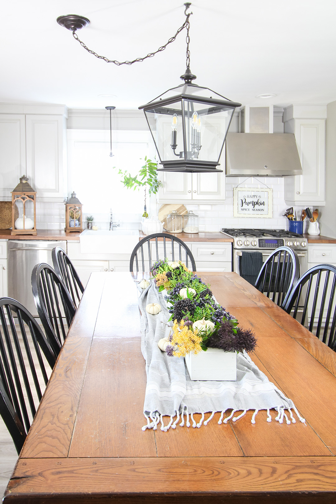 In this post I'll share how I made over my farmhouse style kitchen table and why I painted it! I loved it before, and I love my white kitchen table even more now!
