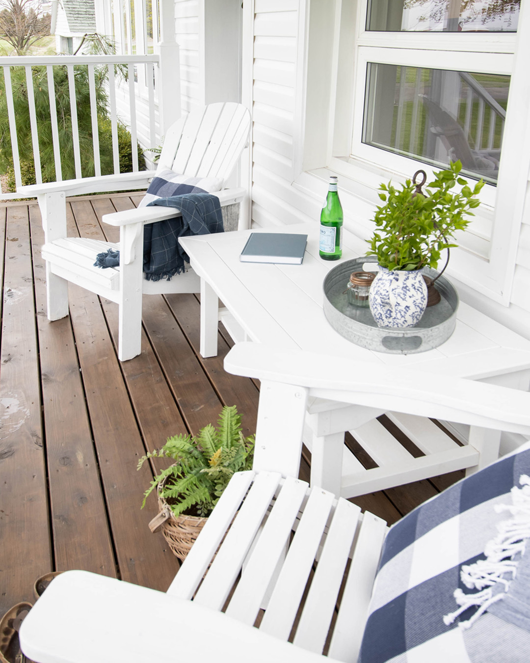 Just some thoughts on setting up an outdoor coffee table that's both pretty to look at and functional! These ideas should keep you from having to run out to your porch to bring everything in every single time it rains this summer!