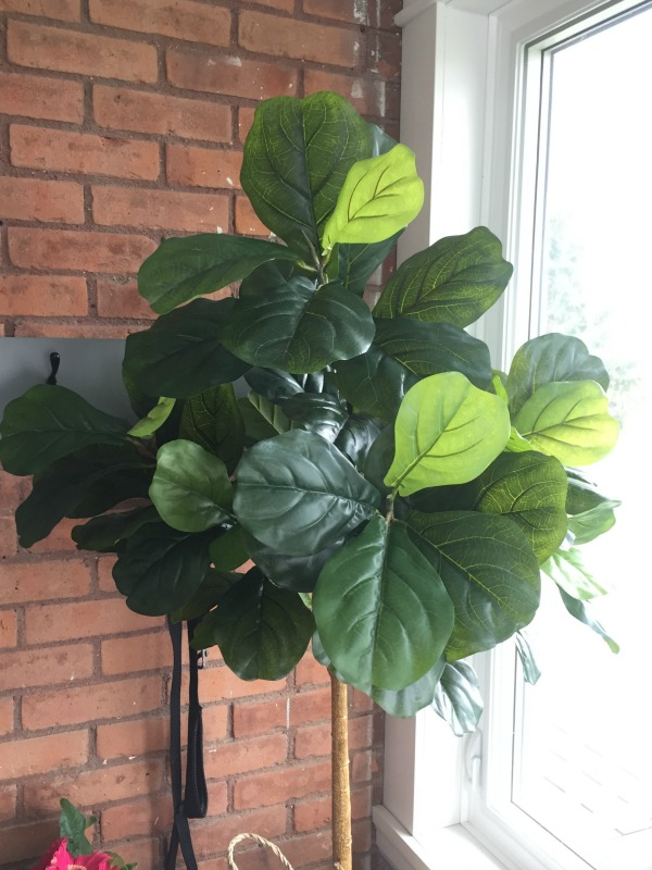 A faux fiddle leaf fig tree can add a good dose of no-maintenance greenery to your home, but they can be a little tricky to get right. Here are my tips!