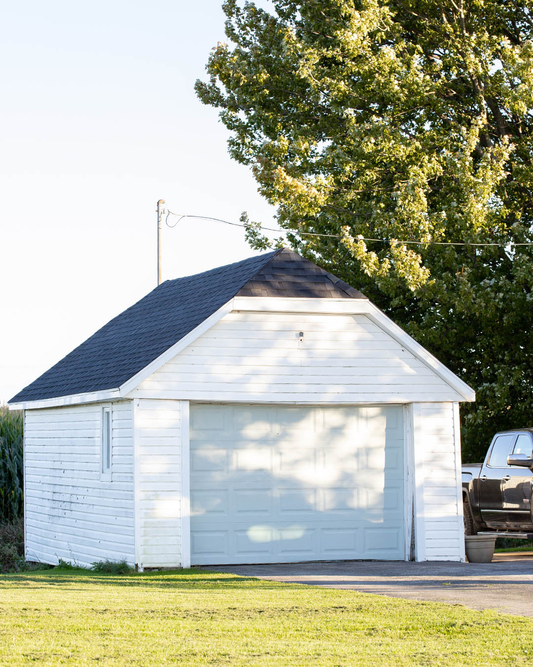 We've started a fun new project! We're fixing up our little old garage to make it look a little more presentable and a little more functional for the cooler months ahead. Here's a look at where we're at with that so far!