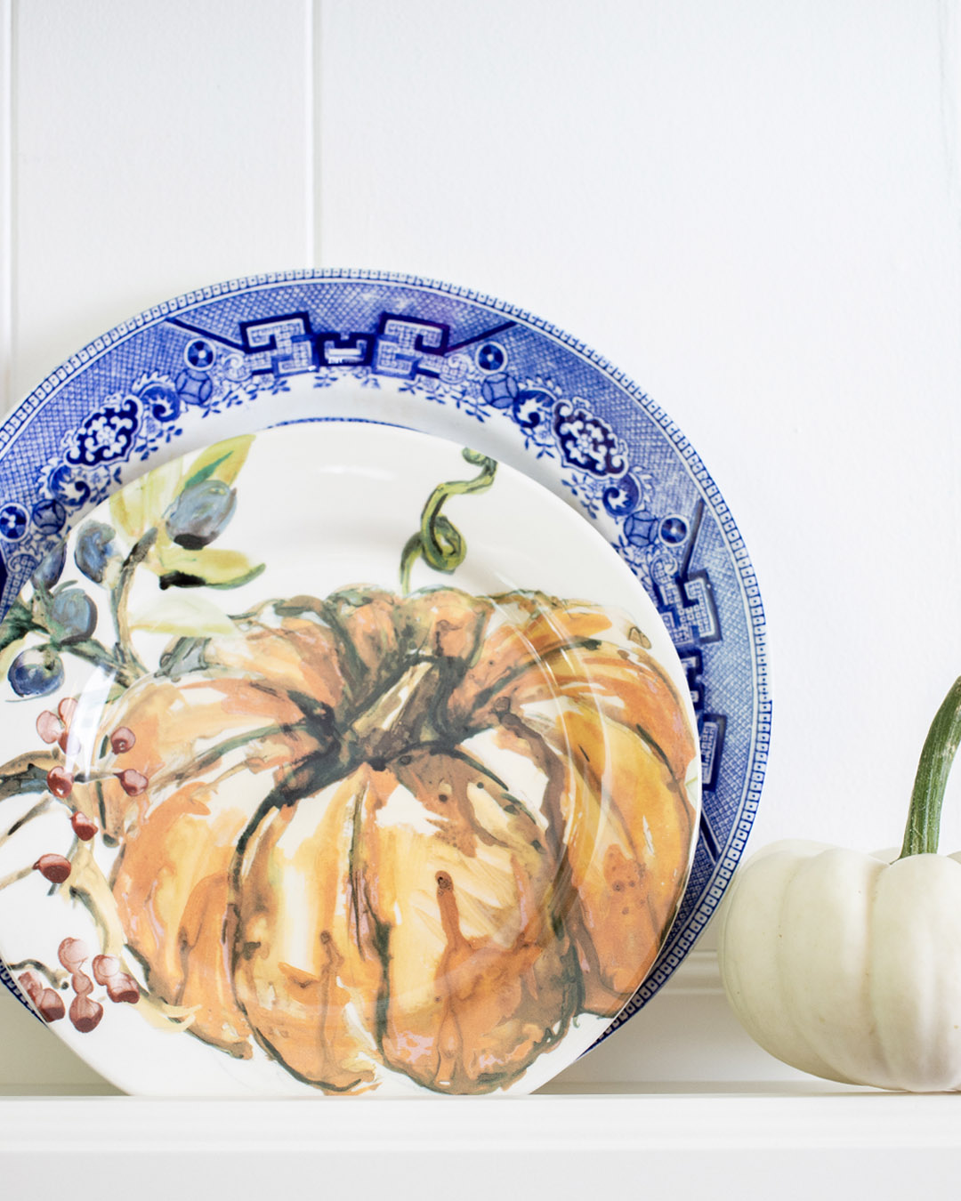 Today I'm sharing one of my favourite little traditions around the house: Switching up my plate wall in the dining room for each new season. Here's my fall plate wall for this year!