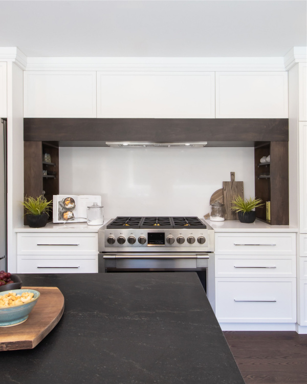 Sharing a few really easy tips to help you update the area around your stove and make it look its best. Here's how to style around a stove!