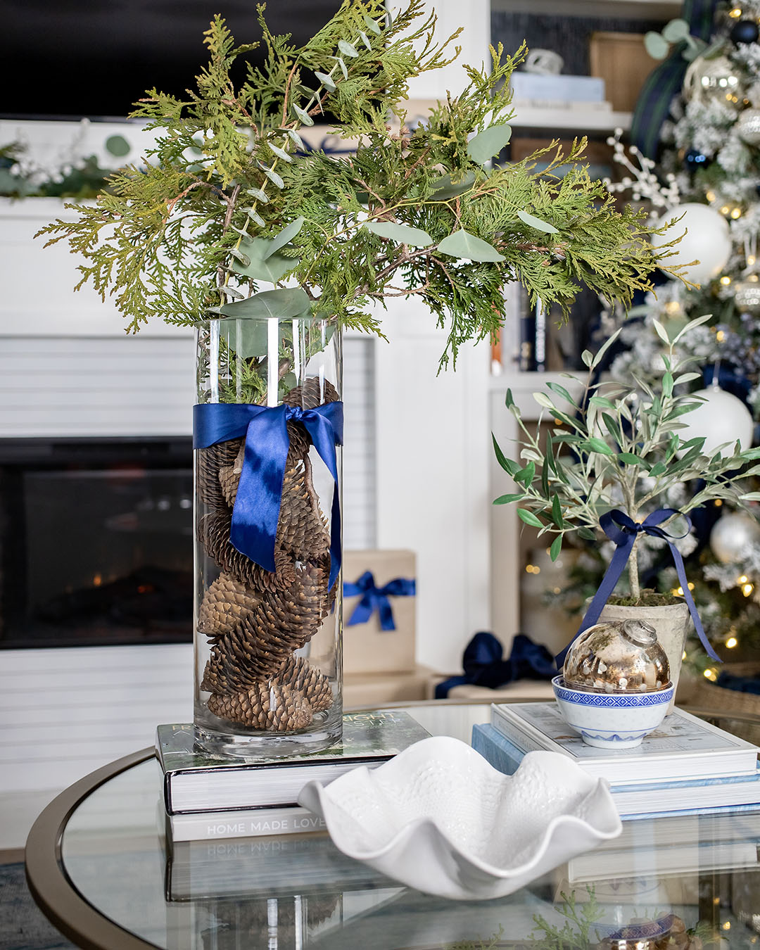 The first tree is up and it's officially Christmas season in our house! Today I'm going to share my blue and white Christmas decor from our living room!
