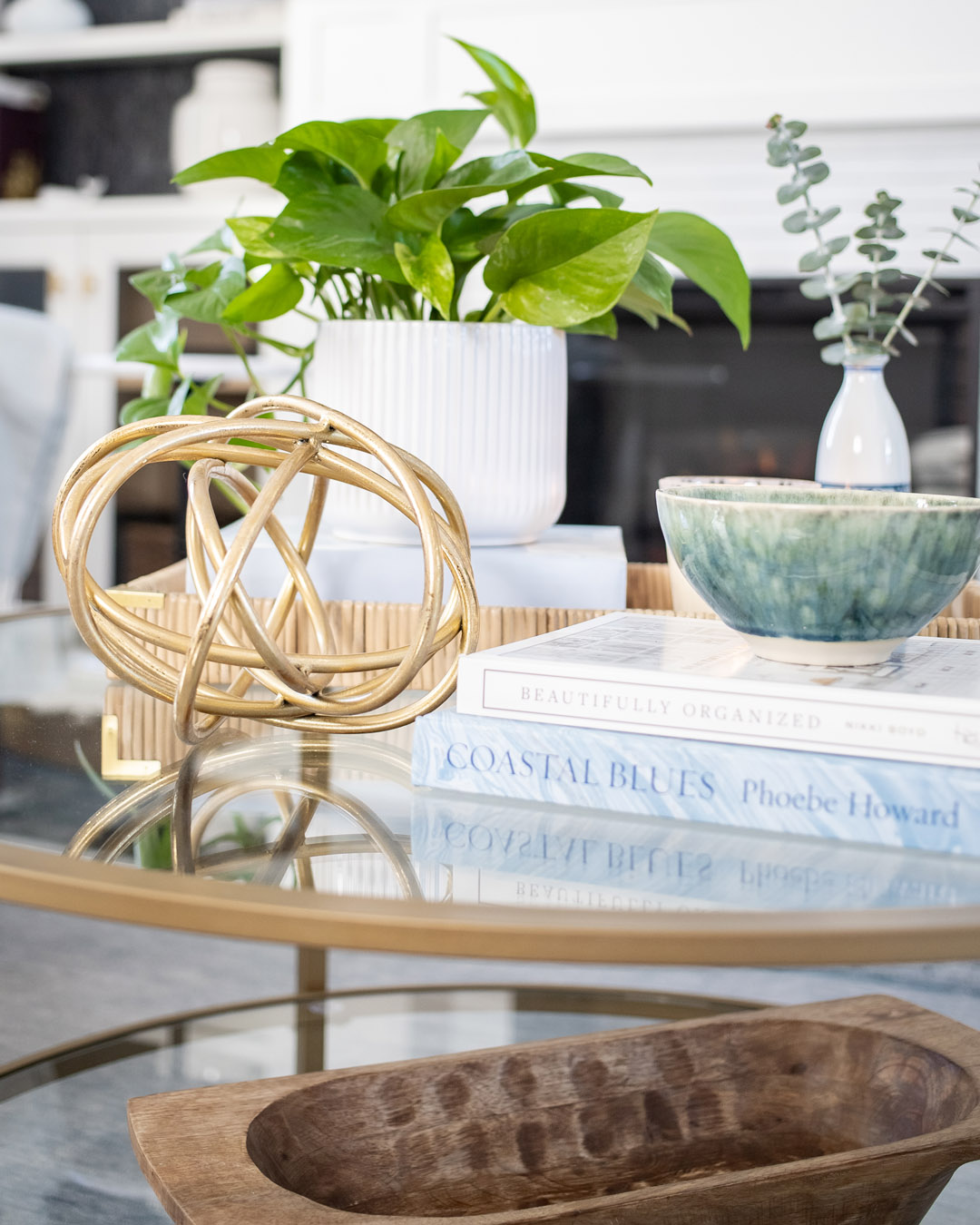Today I thought I'd share a little peek at what our living room looks like right now and maybe give you a few ideas for styling a small round coffee table.