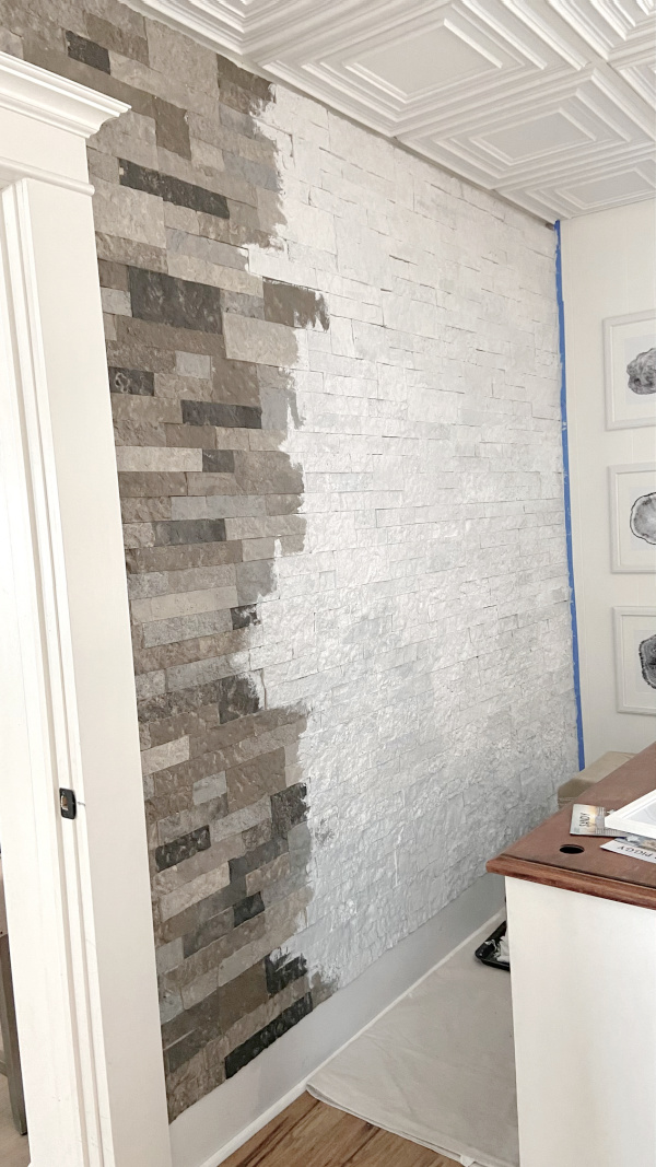 In today's post I'll share the details of how I whitewashed the faux stone wall behind my new desk nook to brighten up the whole space. Here's how to whitewash a stone wall.