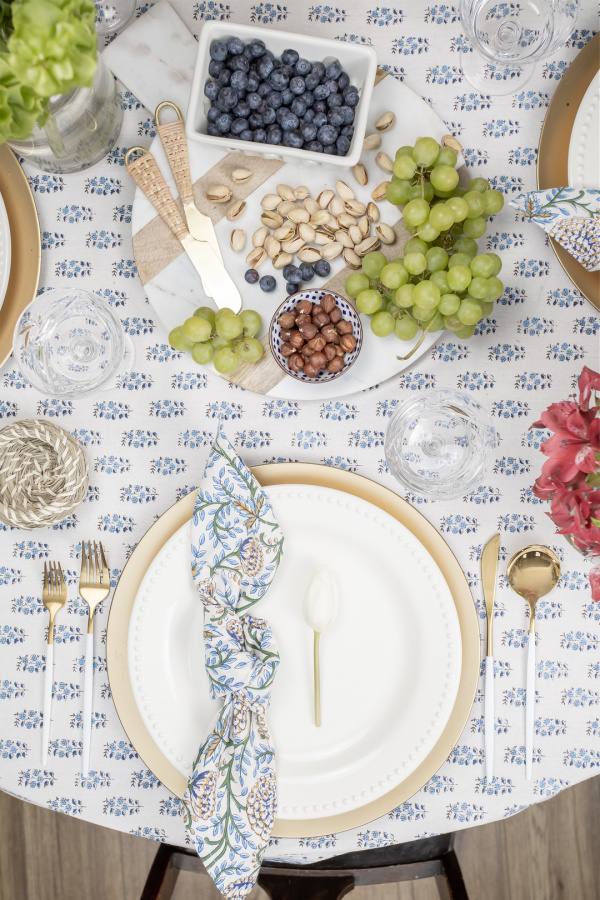 This simple knot napkin fold is perfect for a more modern or understated table setting any time of year.