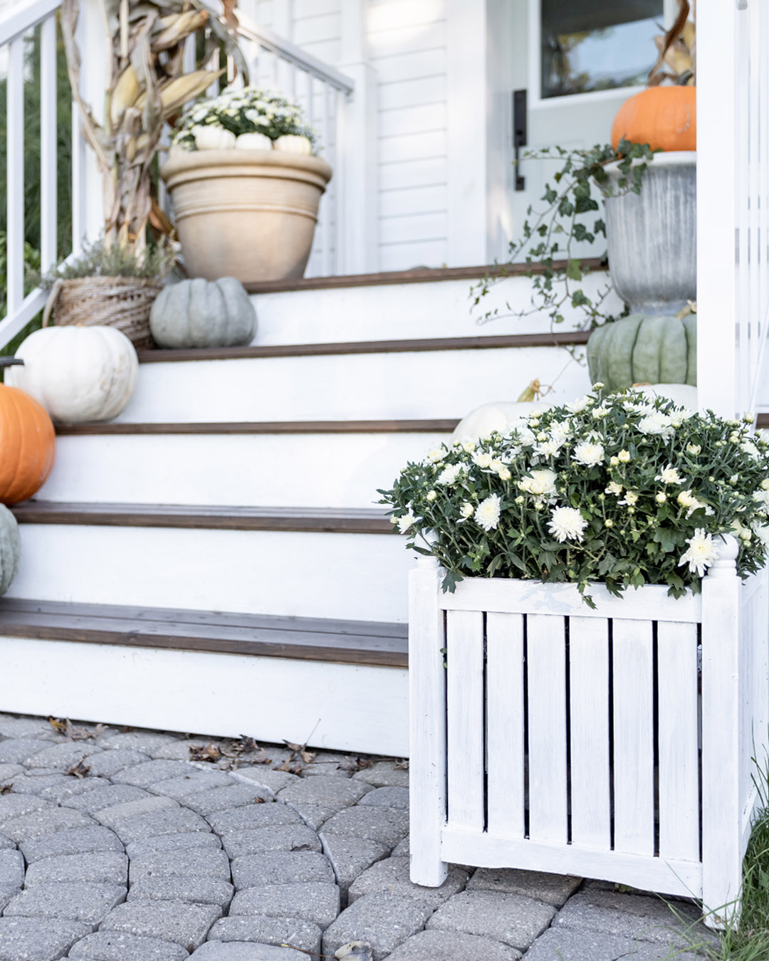 I'm excited to share how we have our front porch decorated this year with you! Here's our simple green and white front porch.